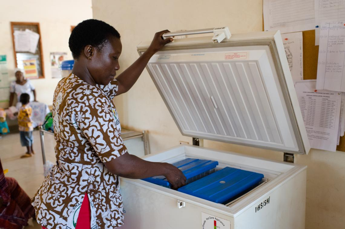 Emelia Kakarba retrieving vaccines from a fridge at a Reproductive and Child Health facility in Savelugu in the Northern Region of Ghana on 26 May 2015.
