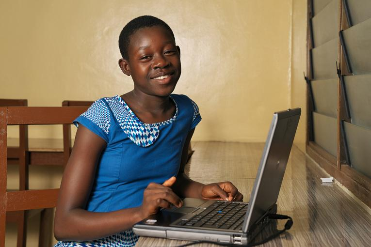 A young girl  using a laptop