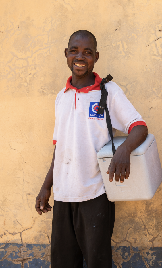 A volunteer carrying a vaccine box