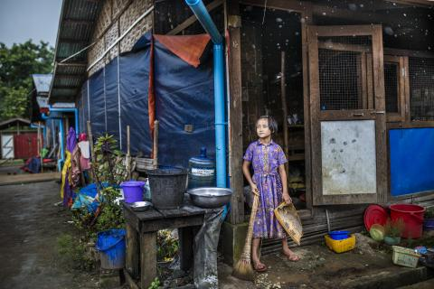 Girl standing in the entraceway of her home at Pa La Na IDP camp on the outskirts of Myitkyina, Kachin, Myanmar