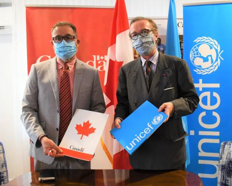 UNICEF Representative and Canadian High Commissioner sign pact