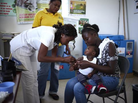 A young child is being vaccinated