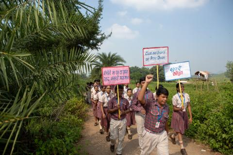 "Students hold banners and spread the message of ""Clean India"", as a bunch of volunteers from DAV Vedanta Int. School undertake their monthly field visit to a new village in the neighboring tribal area of Lanjigarh."