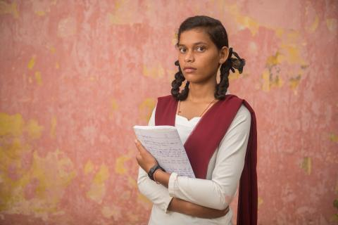 Kusma Kumari poses outside her classroom in the Pirra government school in Kanke block of Ranchi in the central Indian state of Jharkhand.
