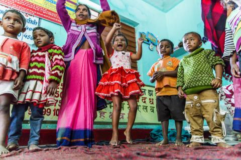 Children and ASHA Workers gather at the Anganwadi Children's centre in Gandhigram Village.