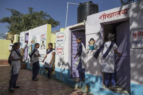 Children using toilet at government primary in Aurangabad.