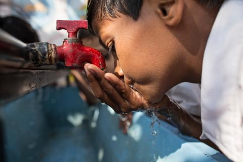 A child drinking water from water tab at his school in western Indian state of Maharashtra.