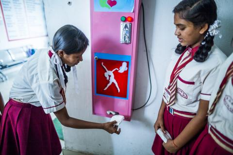 An adolescent girl takes a sanitary napkin as she uses a vending machine installed in the school during a session on Life Skill Education Module as part of Menstrual Health and Hygiene Management for Adolescents Girls project (MAHIMA) an initiative of UNICEF at Kasturba Gandhi Balika Aavasiya Vidyalaya (KGBV) in Patratu.