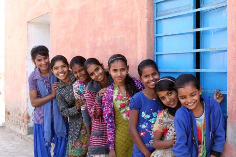 Young adolescent girls pose for a group photograph at the AGG meeting at the Anganwadi Centre, Husangar village, Sri Dungargarh block, Bikaner district, Rajasthan, India.