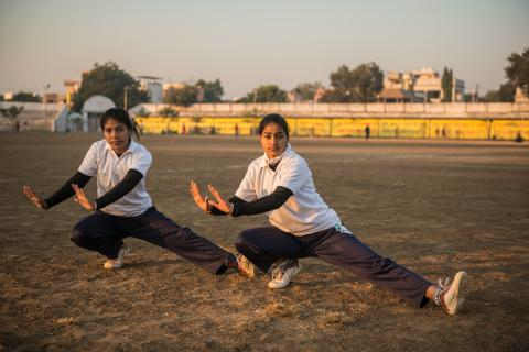 Hemlata Mandrai (Anchor, Right), 18, and Toshiba Qureshi (Co-Anchor), 19, launched The Power of Girls to assemble a girls cricket team not only to emphasize the importance of sports and physical fitness for them, but also to raise awareness about gender and caste discrimination, and sexual harassment.
