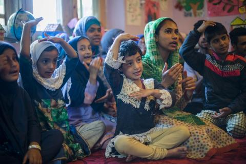 Children react during an activity at the Child Friendly Space (CFS) in Pamposh colony of Srinagar in Jammu and Kashmir.