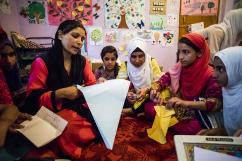 Children learn paper cutting during a session at the Child Friendly Space (CFS) in Pamposh colony of Srinagar in Jammu and Kashmir.
