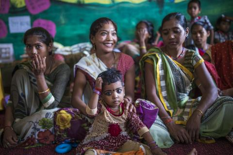Mothers and children attend a meeting as part of Village Health and Nutrition Day (VHND) in Motipur Kala Aanganwadi Centre in Shrawasti, Uttar Pradesh.