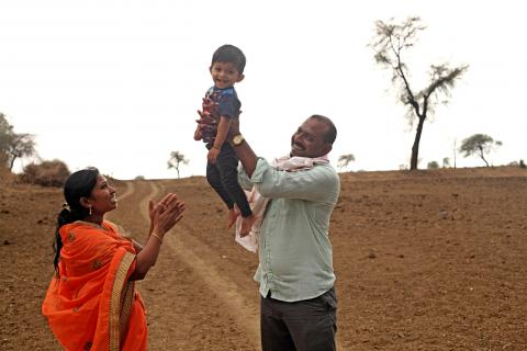Sachin Chaudhary and his wife Swarna Chaudhary playing with their 2 – year old son Krishna Chaudhary.