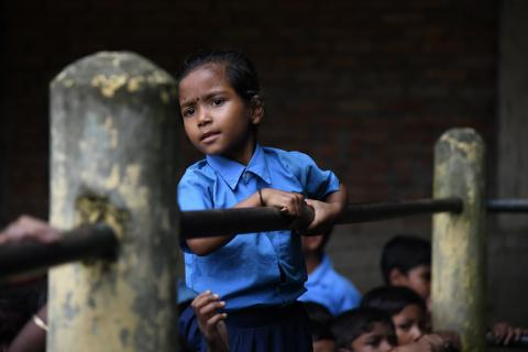 A child standing in school.