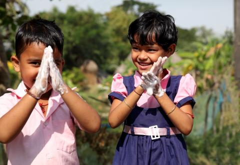 Young children practice safe handwashing at an aanganwadi centre in Raghunathpur, Kujang, Jagatsinghpur, Odisha
