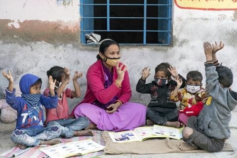 Anganwadi worker Leena Bhat (41 – year – old) playing with the children of the Jethana –A anganwadi Center.