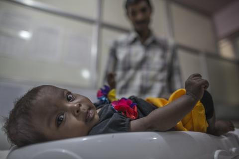Aditya Veersingh Vasave, nine month old, laid down on weight machine inside Nutrition Rehabillitation Centre ward at Government District Hospital.