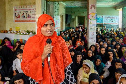 Samira Yunus speaks at an adolescent forum,