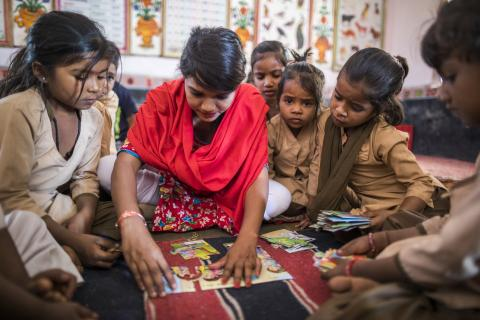 Children react as they learn by solving puzzles while 27 year old anita Parmar, a teacher, conducts a session in a classroom in Upper Primary school in Gouth Mahudi, Dungarpur.
