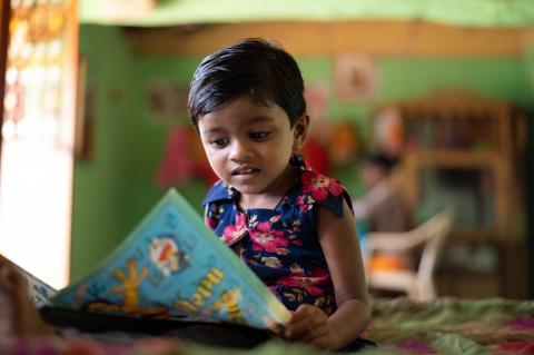 Three-year-old Dhruvi reading