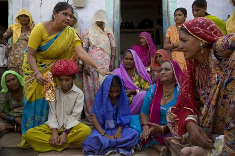 Snehlata (in glasses) explains the harmful effects of child marriage to women in Agolai Village, Jodhpur District, Rajasthan State.