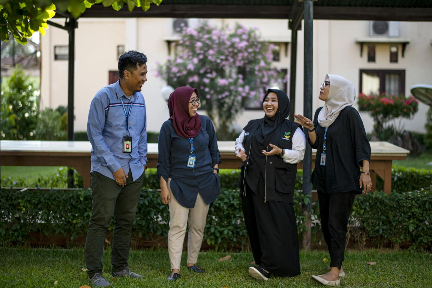 Robby Saputra (33), Ramadhani Sri Handayani (32), Nurfanny (30), and Triyana Sari (30) pose in front of the camera in the park in the Social Office office area in Palu, Central Sulawesi, Indonesia, on 11 September 2019.