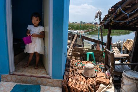 A girl stands inside her family's newly constructed toilet outside their home in Tegaldowo village, Central Java Province.