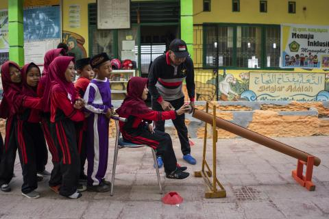 Children participate in a game at school