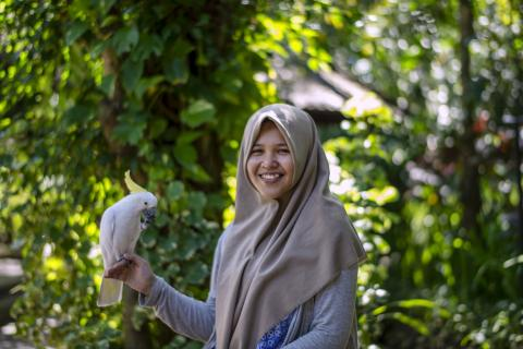 Rizka with bird