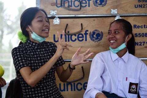 Mega & Chila, children with disabilities in UNICEF tent