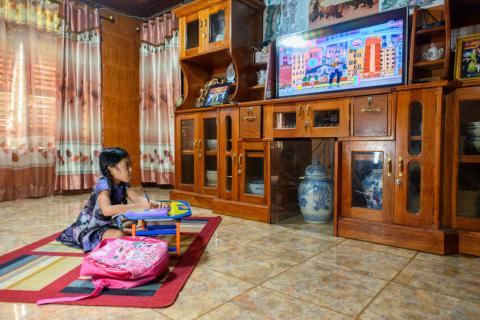 Moreyna follows an educational TV programme at home