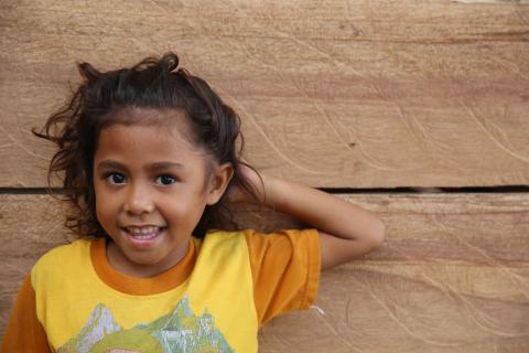 A young girl smiling.