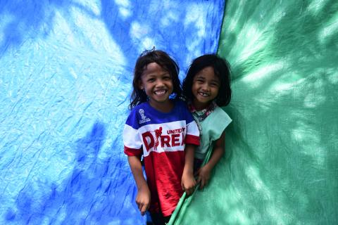 Windy (7) and Rara (5) sharing a smile in the child-friendly space in Palu supported by UNICEF, despite everything they must have gone through during and after the earthquake and tsunami.