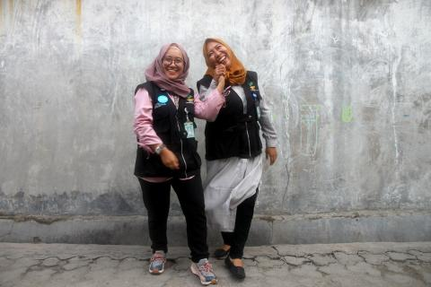 Social workers Kina Sidik and Chi Ramadhani work as part of the family tracing and reunification programme in Central Sulawesi.
