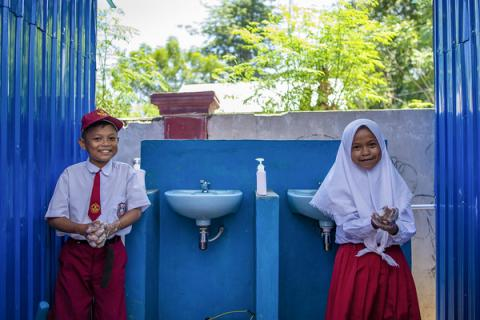 Students wash their hands