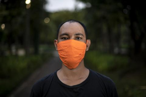 A man wears a protective face mask