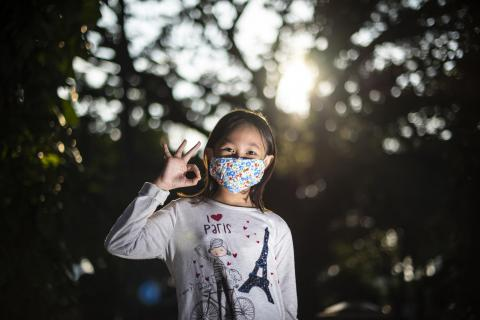 Adelina Salasika, 8, pictured wearing a cloth mask