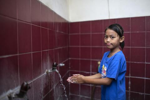 Keysha Nayara Effeni, 8, washes her hands with soap at her home