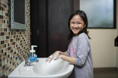 Adelina Salasika (Sika), 8, washes her hands with soap