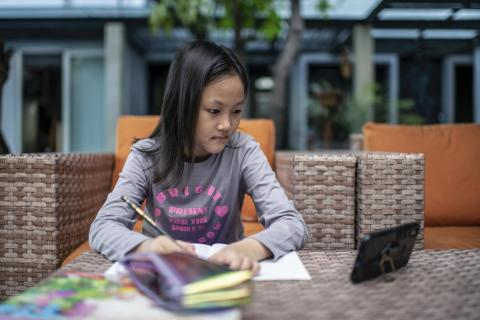Adelina Salasika (Sika), 8, studies at her home in Jakarta