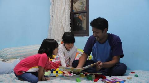 Father helps two children to study