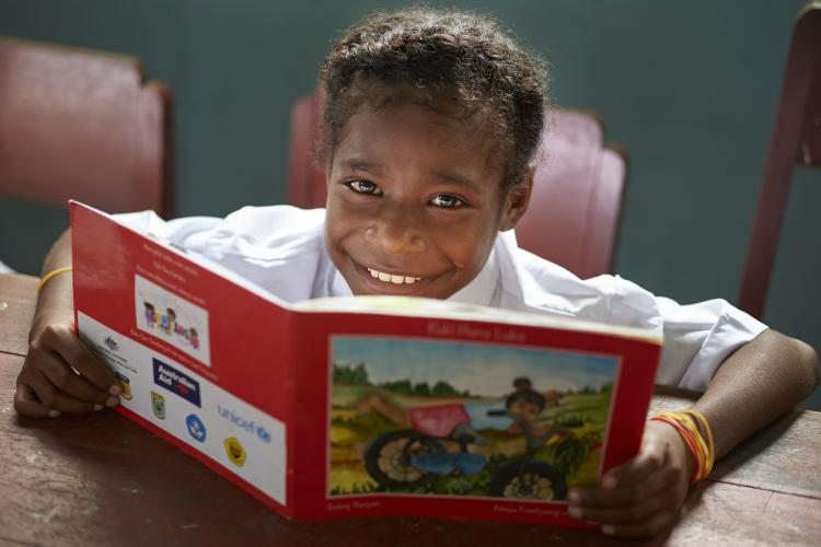 Reading books in Papua