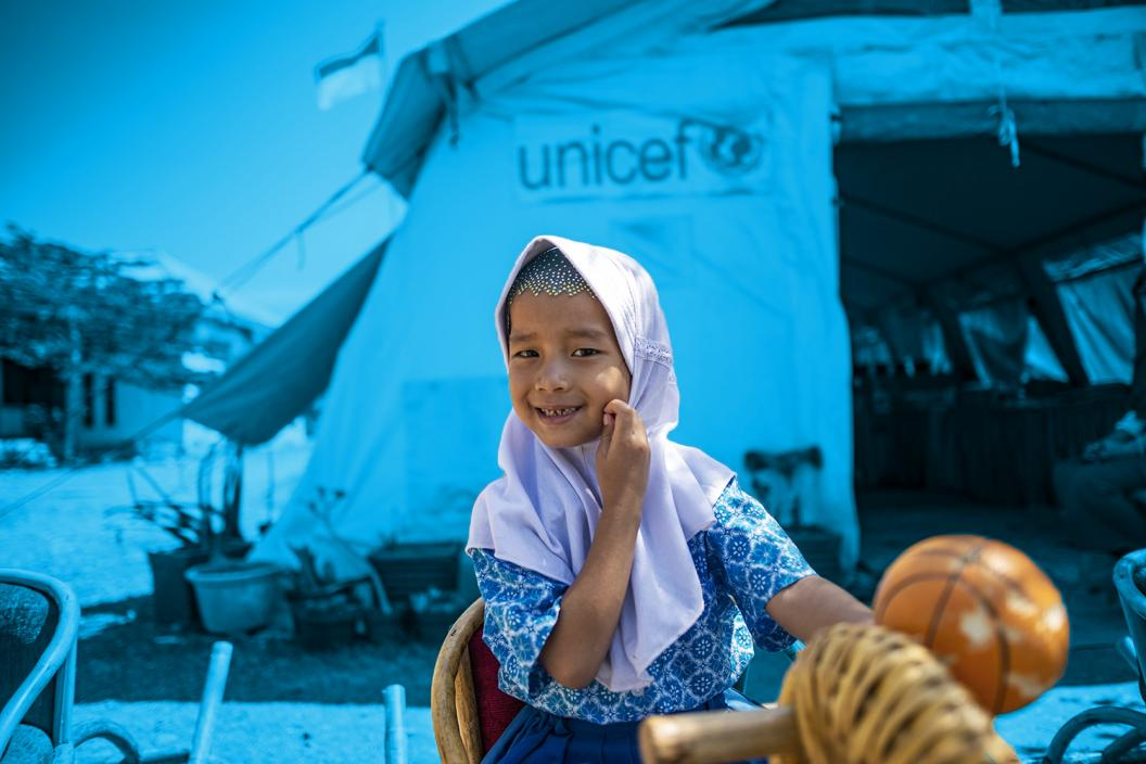 Novia, 5, plays in front of the UNICEF tent during a lunch break