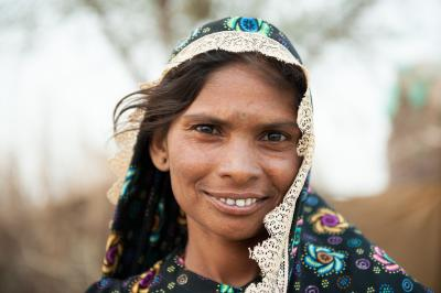 Woman from Pakistan smiling in front of the camera