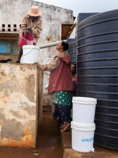People get drinking water from water tank