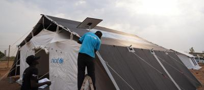 UNICEF Staff building the high performance tents