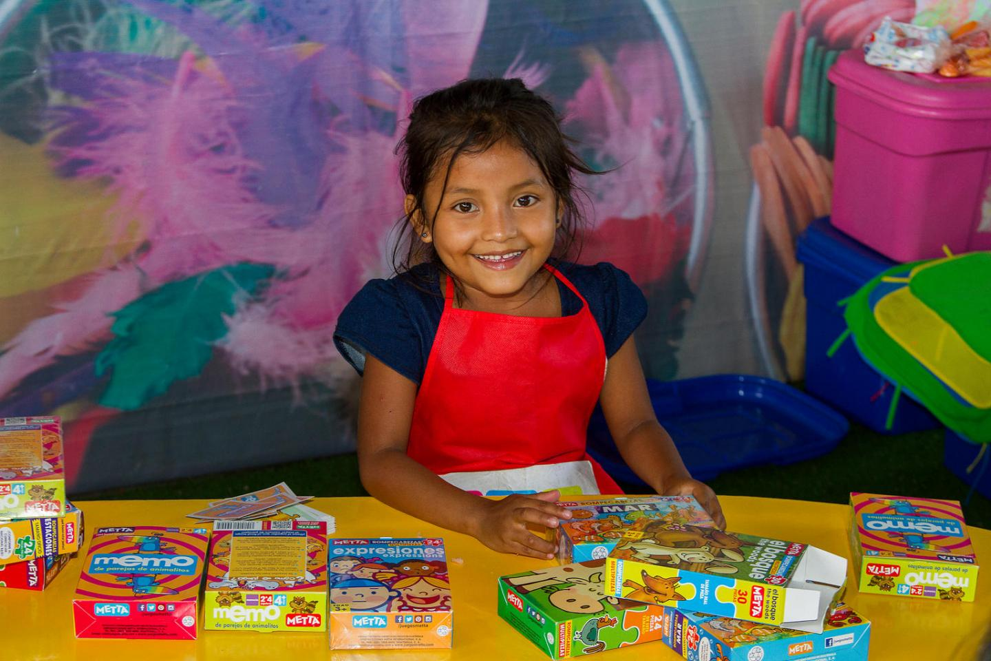 6-year-old Juana Cristina, smiling, in the El Rodeo community in Escuintla Department