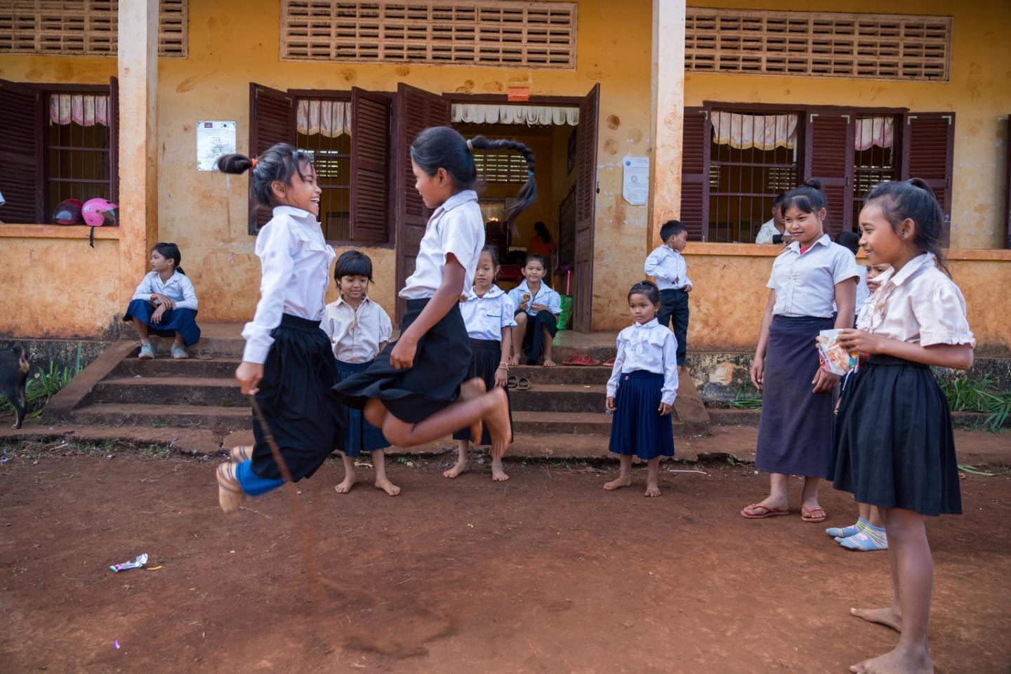 girls in cambodia in school playing during a break