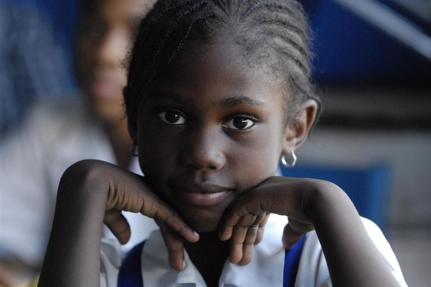 A schoolgirl listens to a discussion on non-violence during the visit of UNICEF Advocate for Children Affected by War Ishmael Beah
